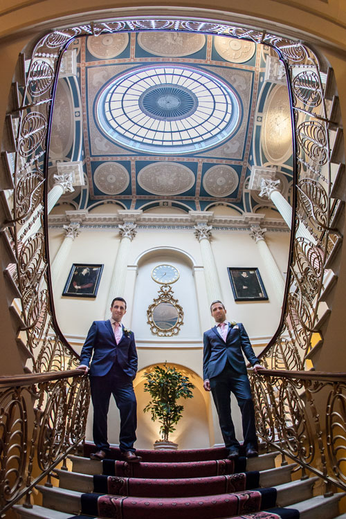 Wedding Brocket Hall stairs with groom image