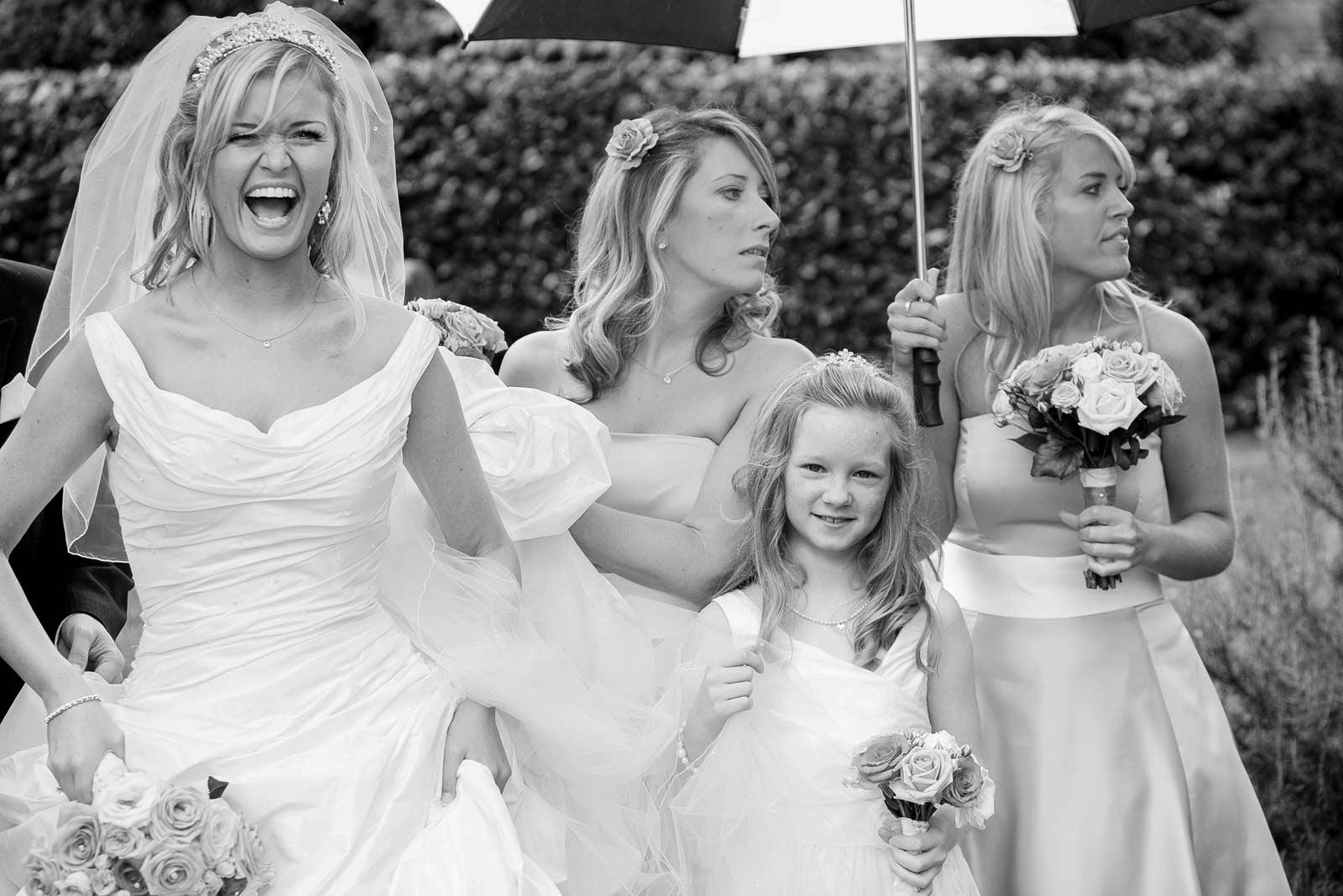 Barnet wedding photographer laughing in the rain
