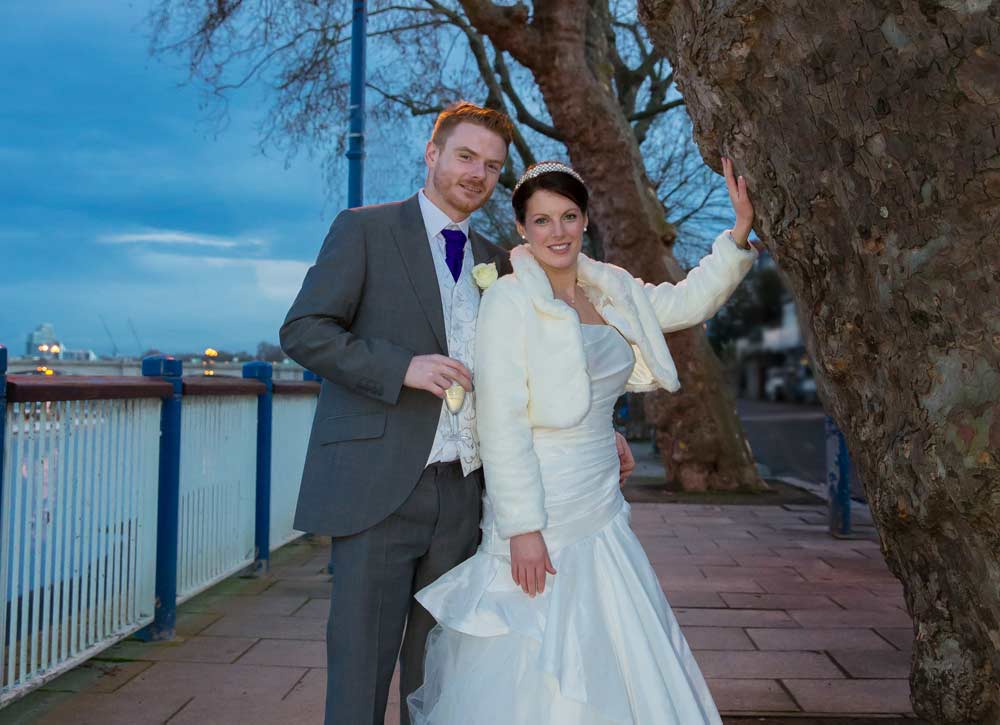 wedding couple stood by Thames photo