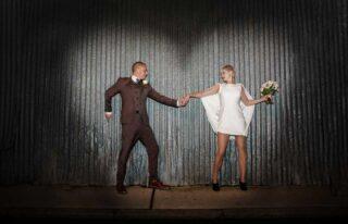 Hoxton wedding shot against corrugated iron