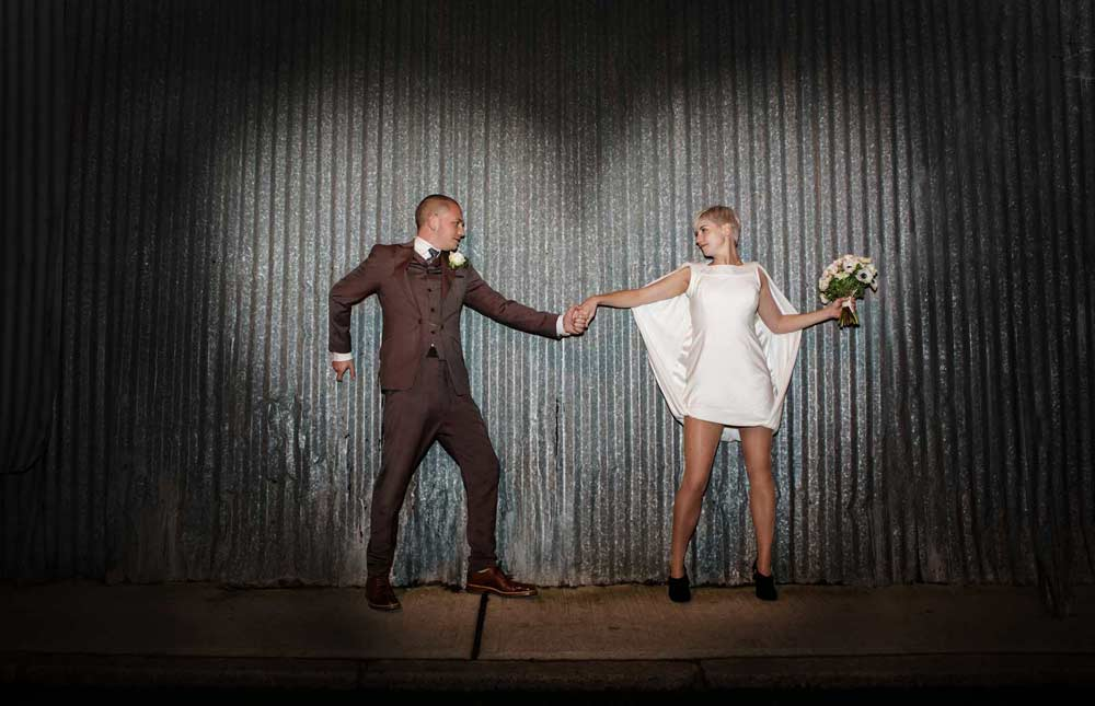 Hoxton wedding shot against corrugated iron