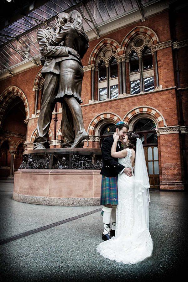 Kissing at St Pancras station wedding