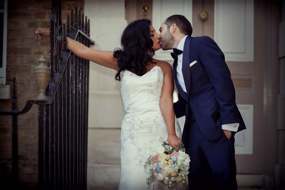 wedding kisses at Devonshire Square photo