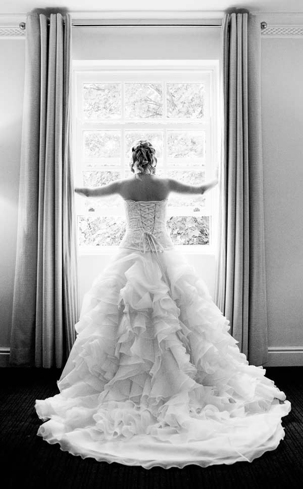 Bride looks through Sopwell house photo