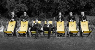 boys on deckchairs at Wiltshire wedding