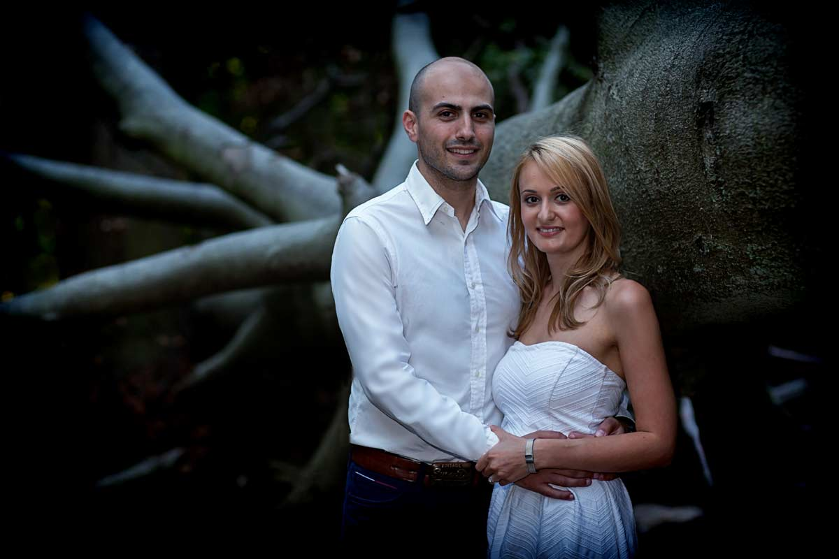couple by tree in London engagement shoot
