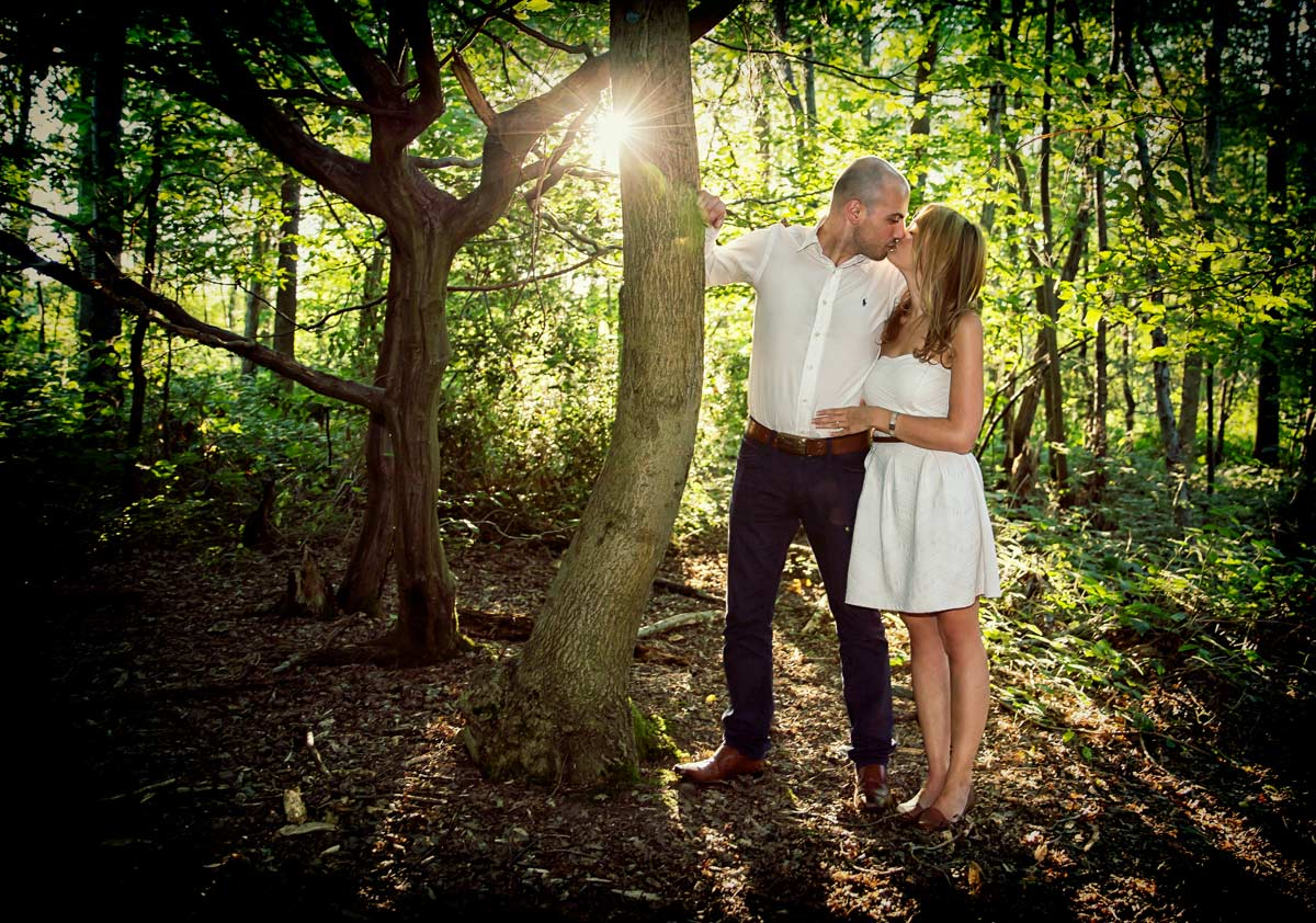 wedding couple kissing in London forest