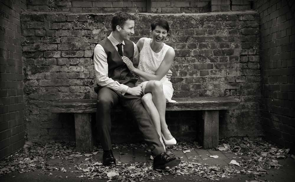 wedding couple on Aldgate bench 1