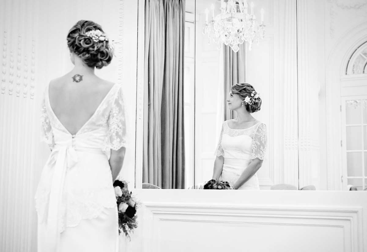 Bride looks through window at Mandarin Oriental Hotel
