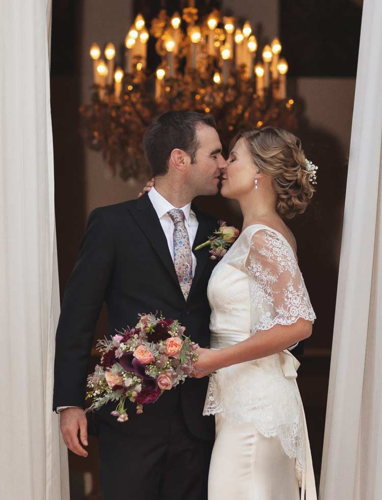 kissing wedding couple London's Knightsbridge