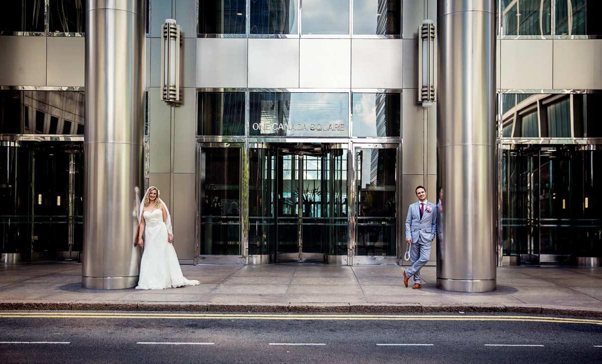 wedding couple pose at Canada square Canary Wharf