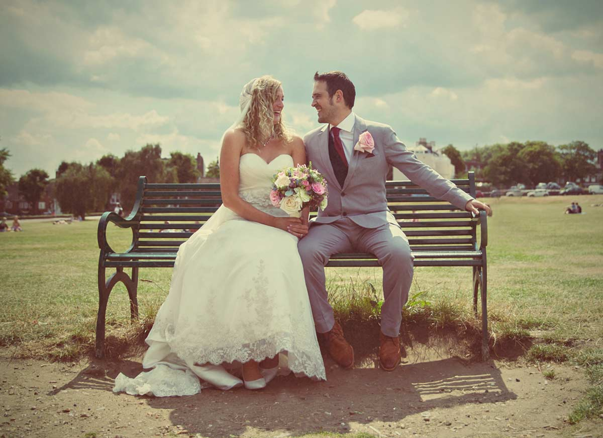 wedding couple sat on bench Blackheath London