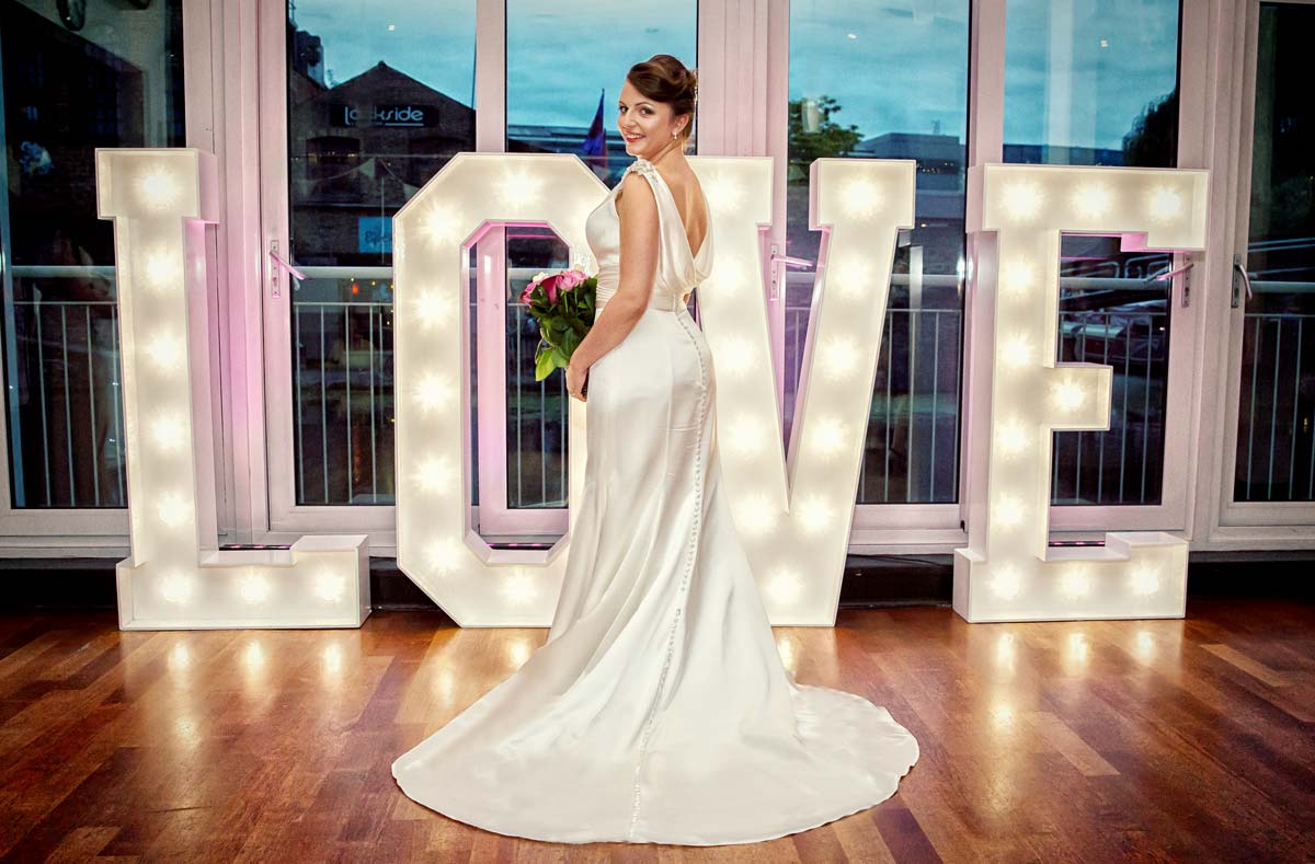 Bride by Love sign light at Camden wedding Holiday Inn