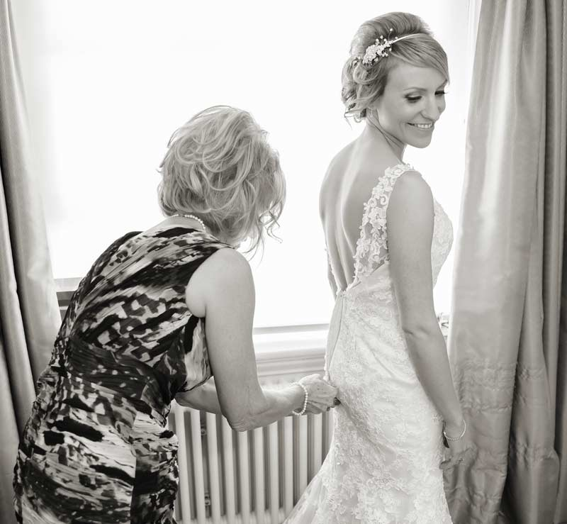 Bride dressing at Caledonian Club wedding
