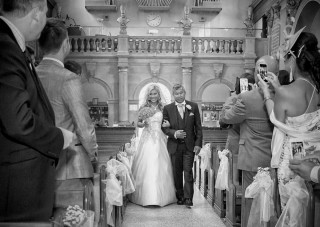 Bride in aisle Essex wedding day