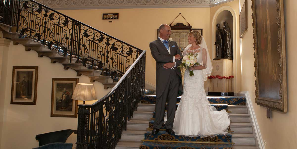 Bride on stairs of London Caledonian Club