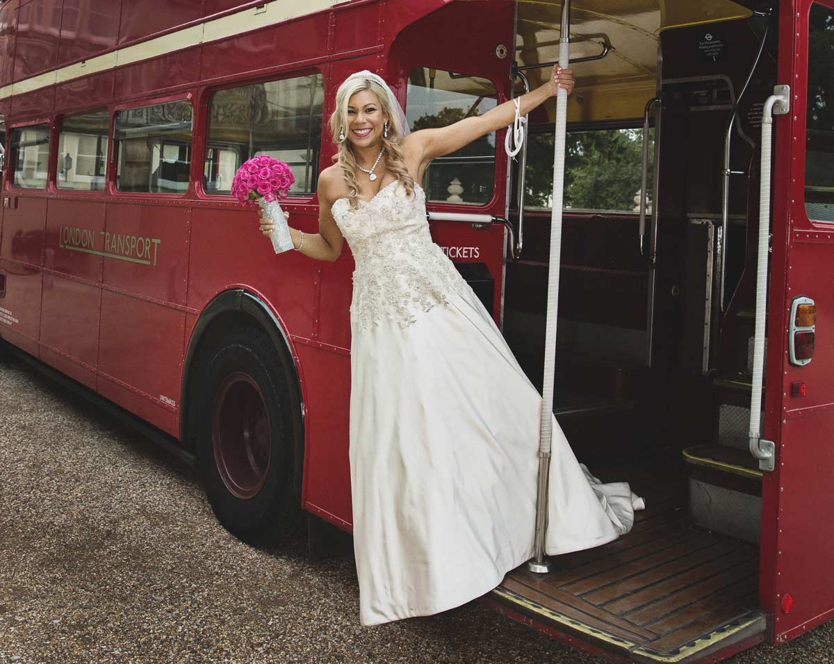 bride leaning out of Routemaster bus