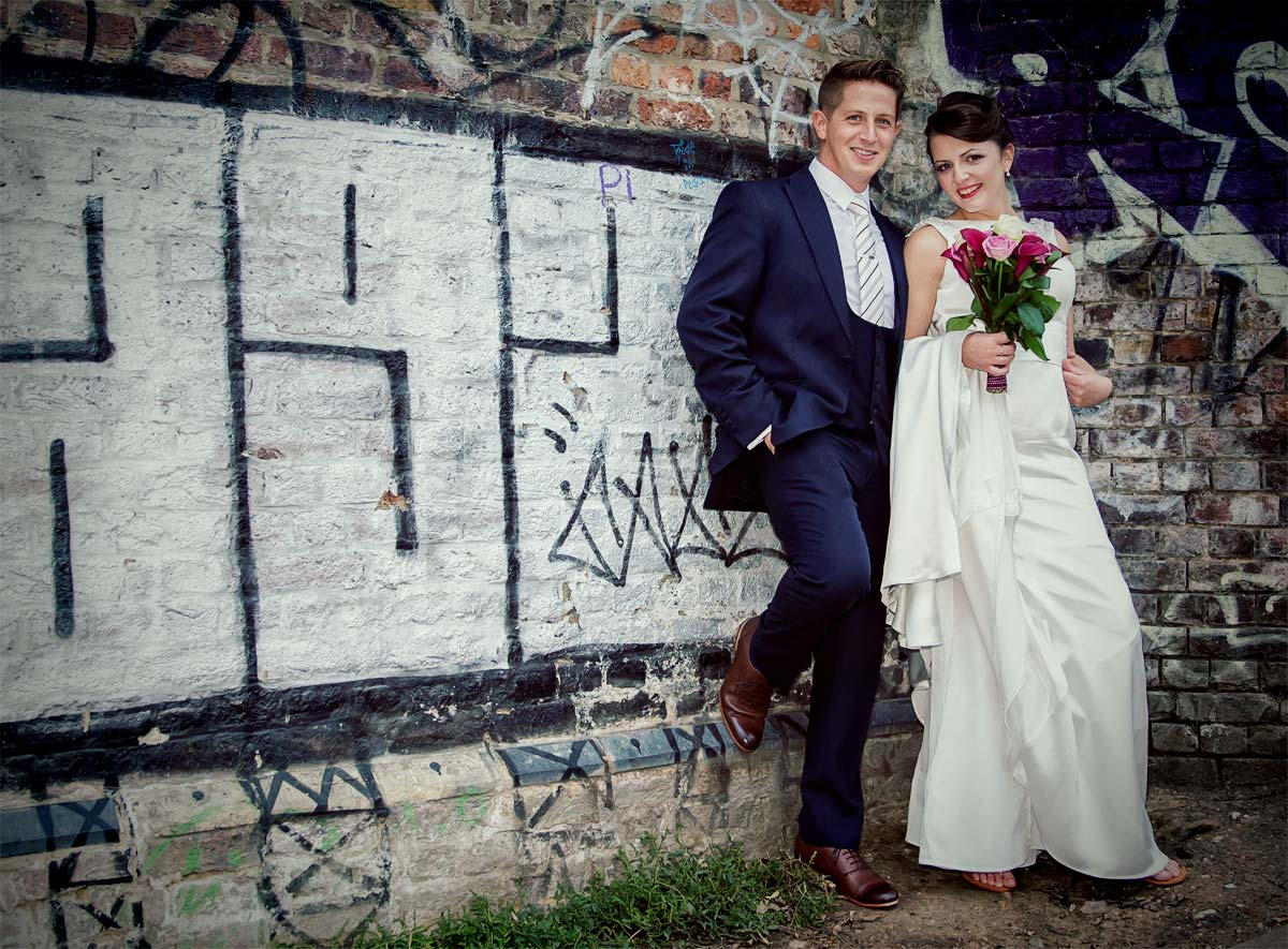 couple by graffiti in Camden on their wedding day image