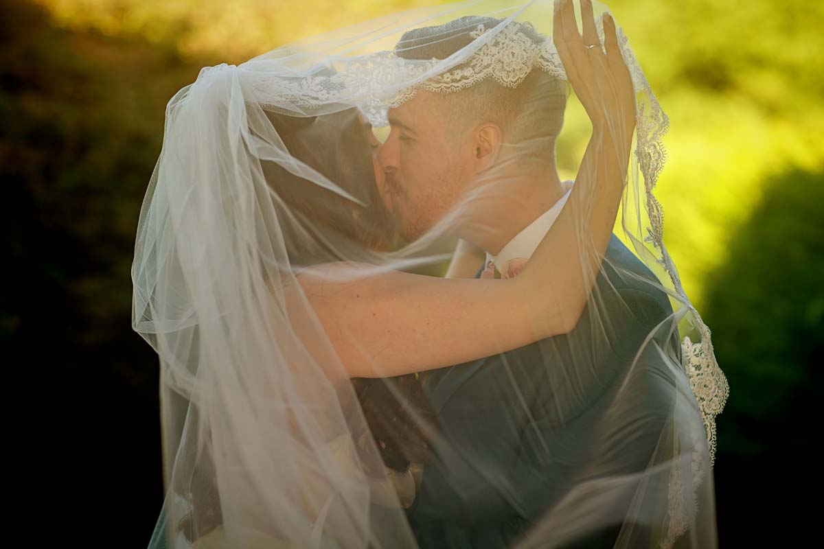 couple under veil Offley wedding