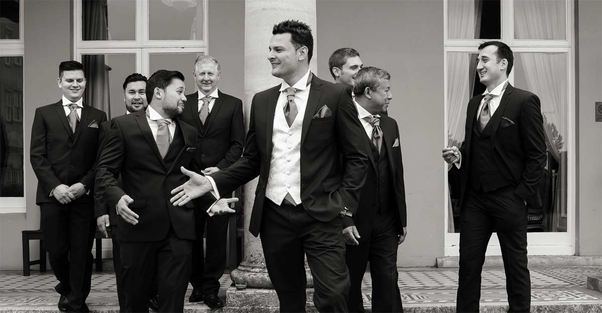 groomsmen talking at Down Hall Essex