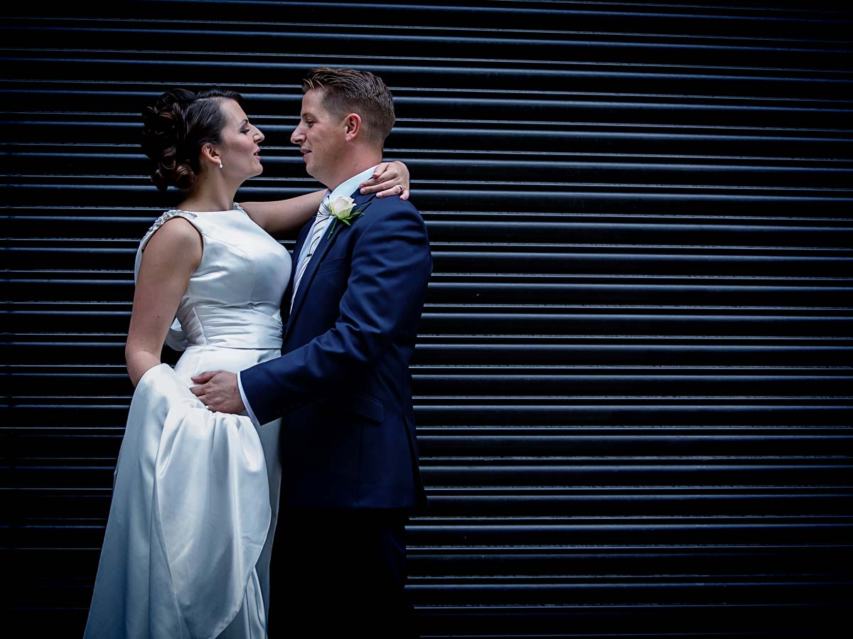 newly weds in front of London roller doors Camden