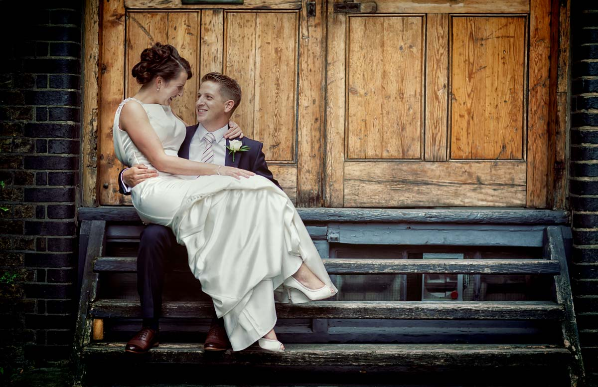 wedding couple on steps of Bleeding Heart Yard