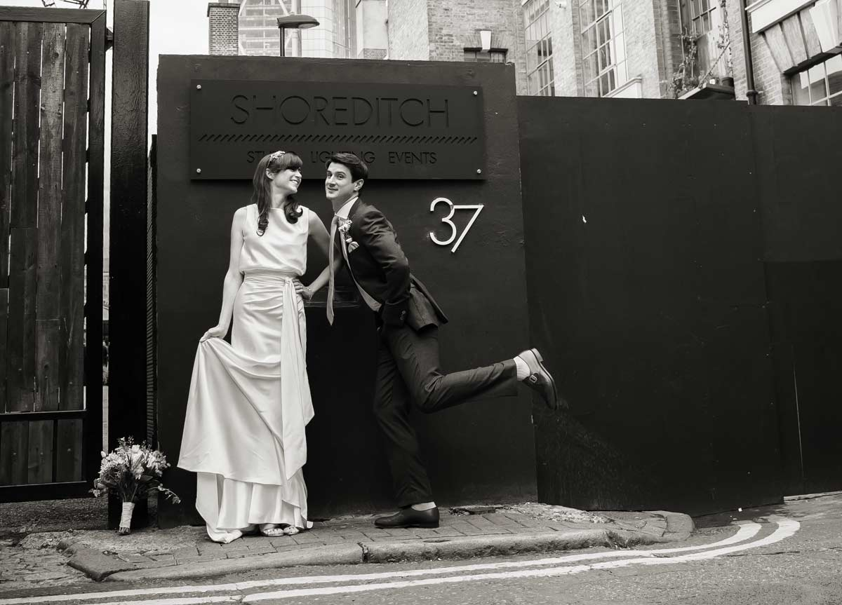 wedding couple shot messing around Shoreditch studios