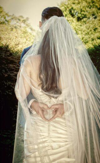 wedding heart behind London bride