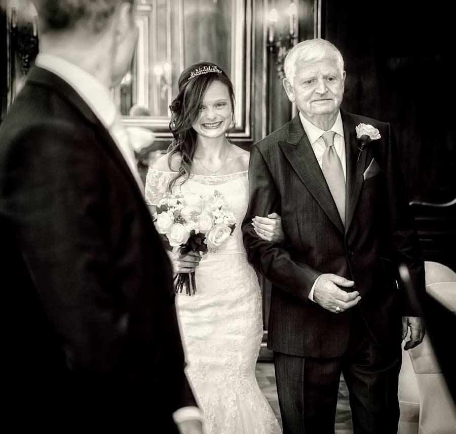bride walks down aisle Kensington wedding