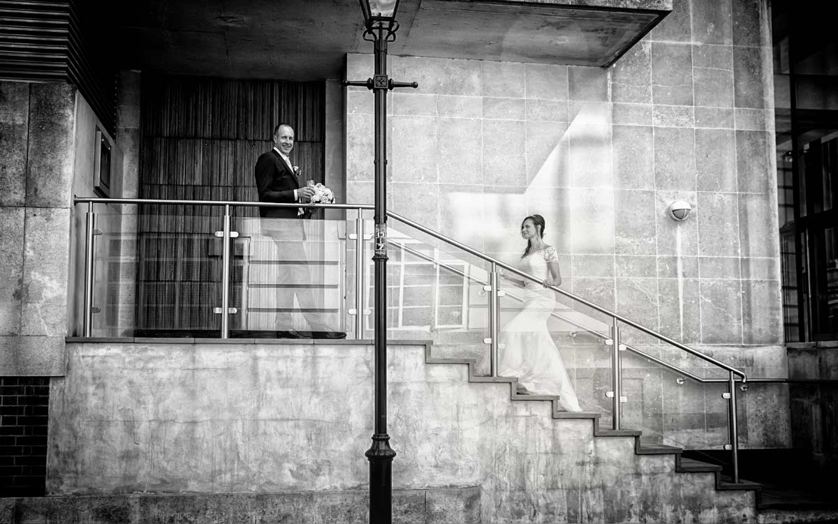 wedding couple pose on steps in London's Kensington