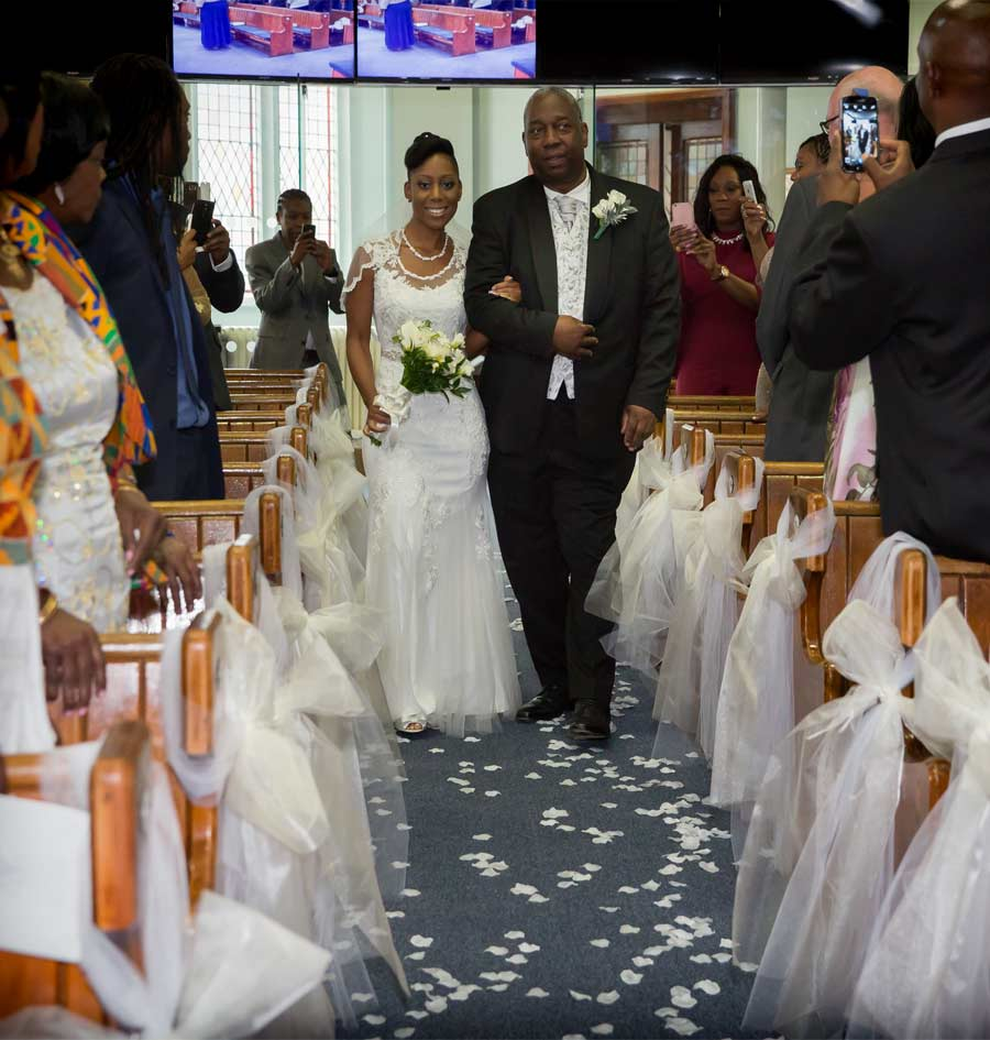 Bride comes down the aisle in London church