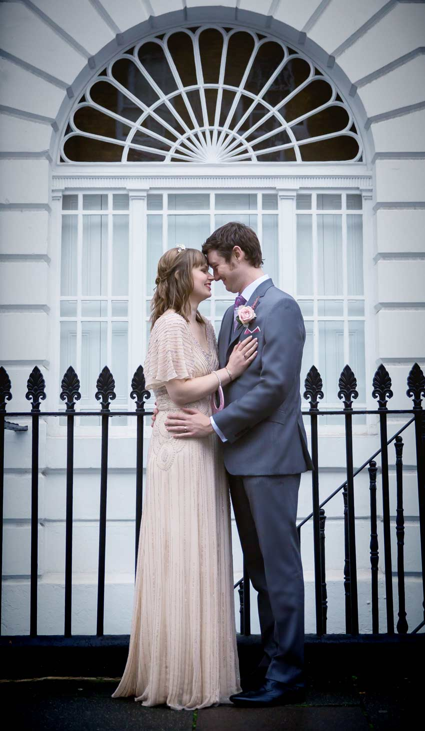 Couple pose head to head at Islington wedding