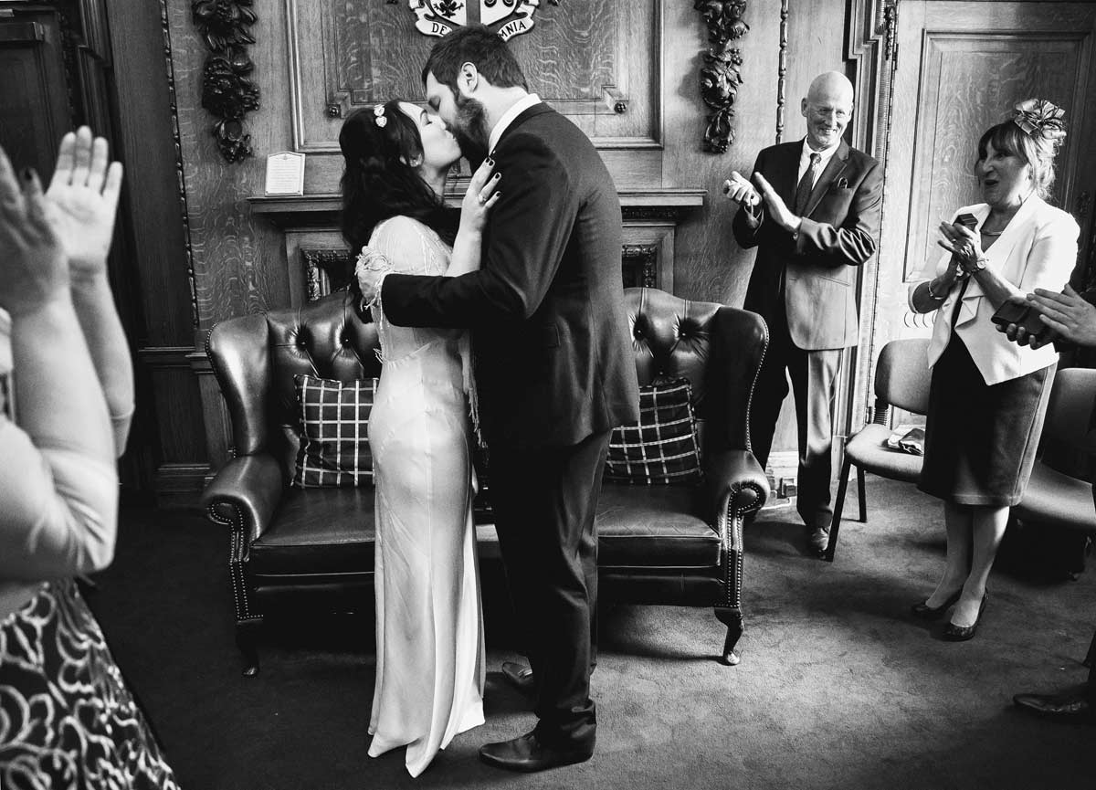 Final kiss at Islington wedding ceremony