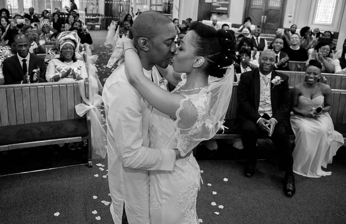 First kiss for husband and wife at South London Ghanian wedding ceremony