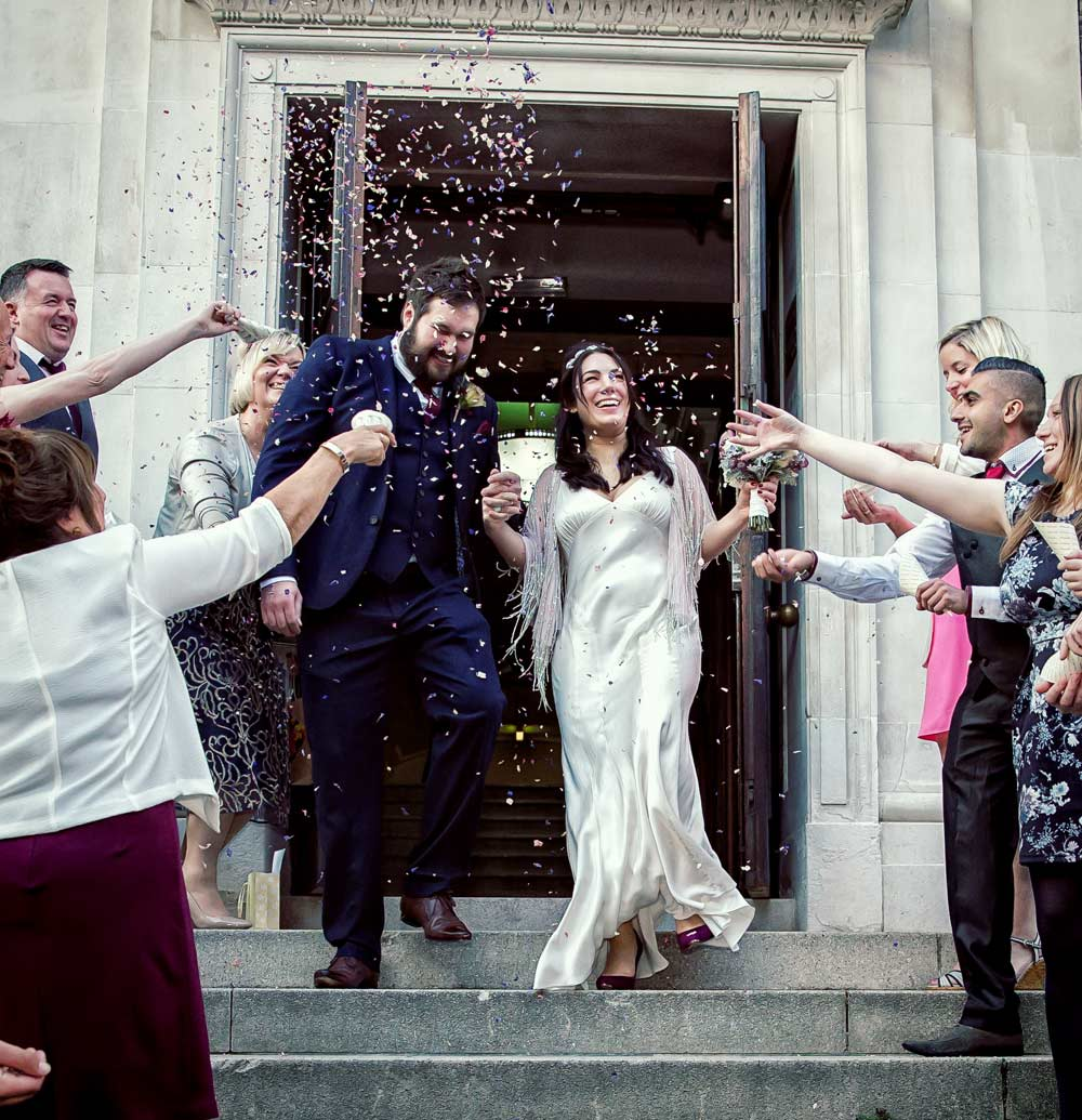 image of wedding party throwing confetti atIslington Town Hall