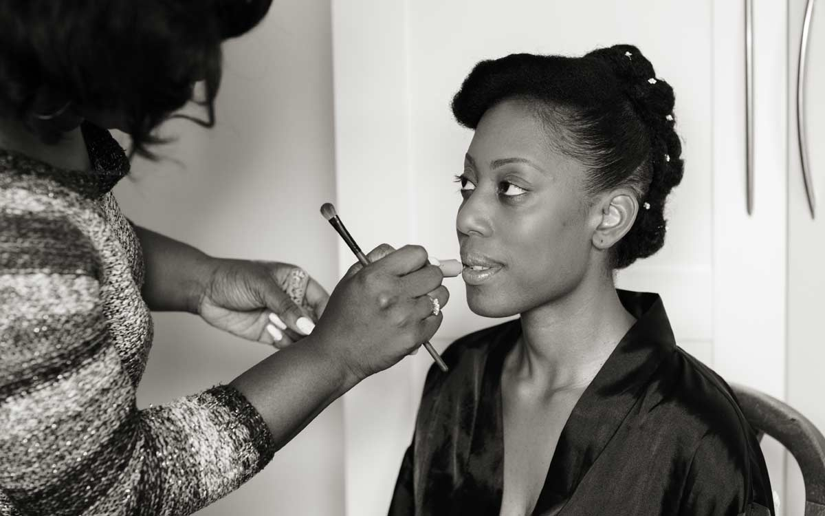Makeup being applied to bride before her London wedding day