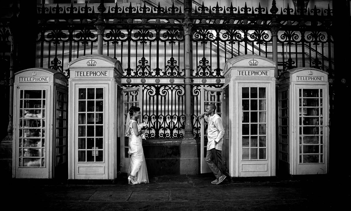 Phone boxes and bride and groom in Smithfield Market London