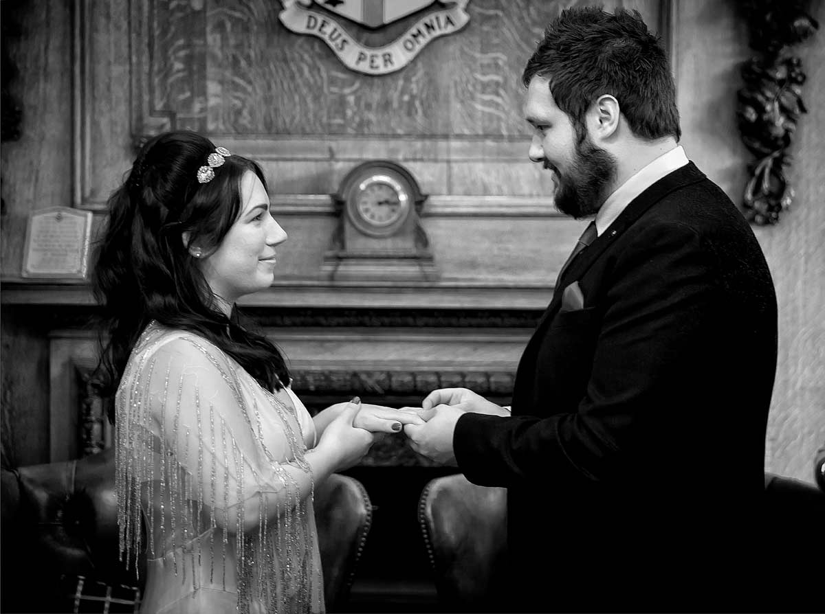 Photo of exchanging of wedding rings at Islington Town Hall