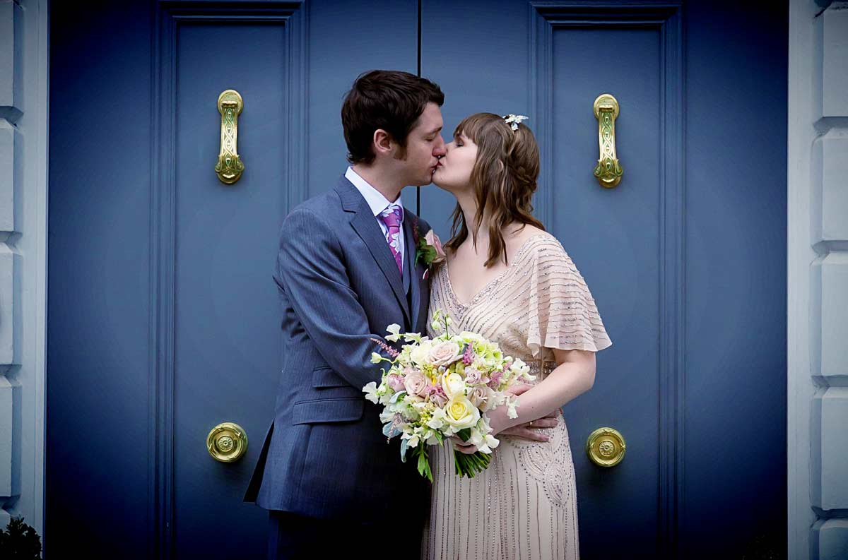 kissing by the blue door Peasant pub Clerkenwell wedding shot