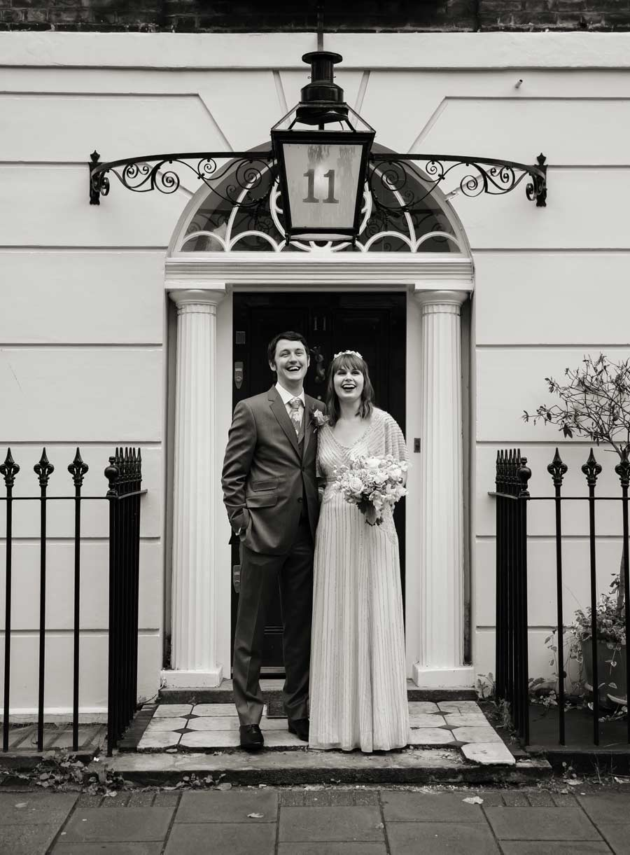 photo taken in door way central London wedding day