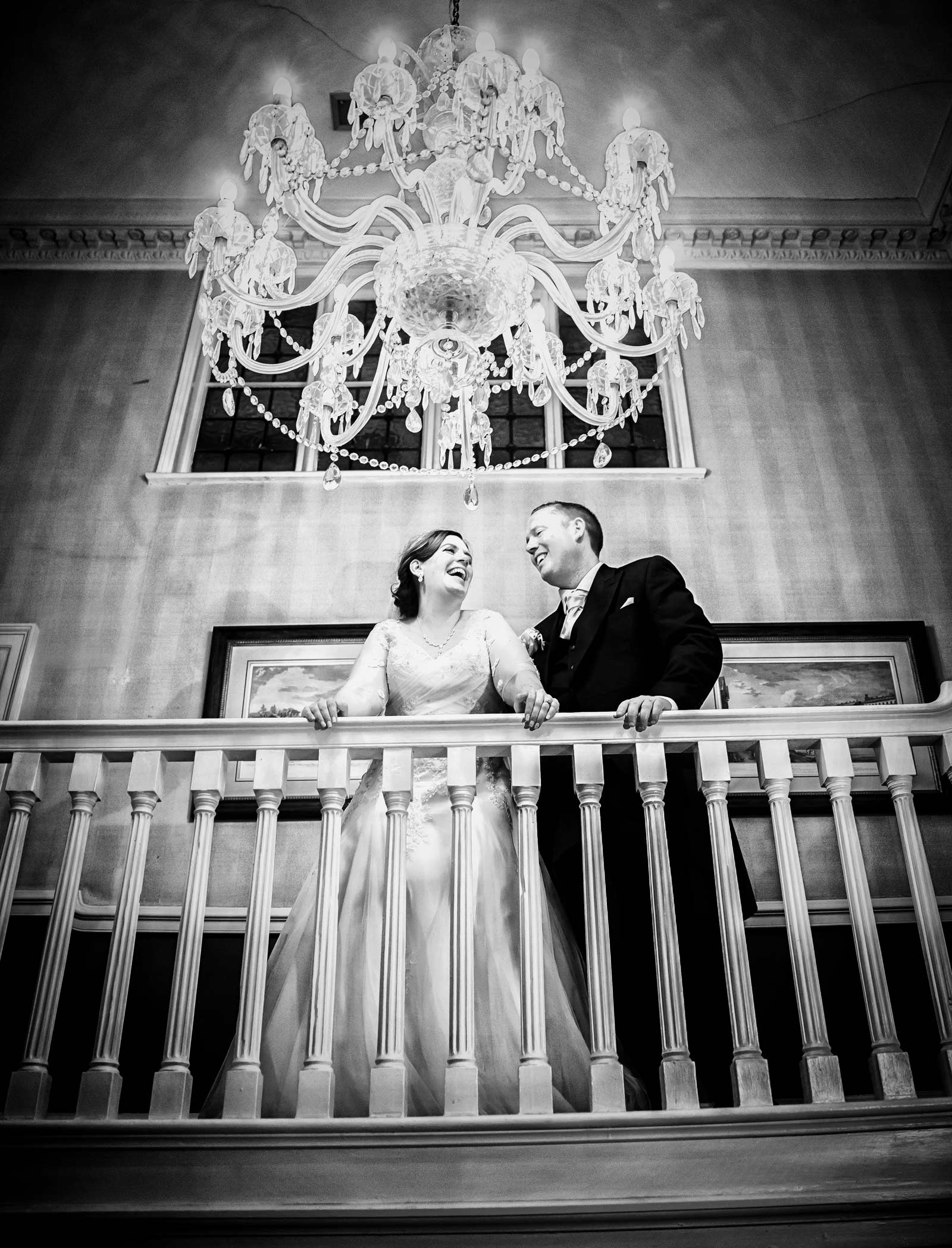 wedding couple by chandelier Hendon Hall London