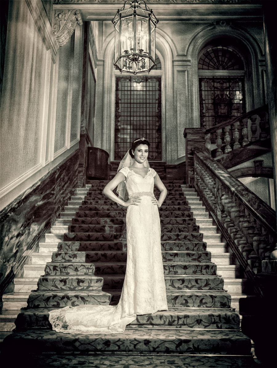 Bride stands on reception stairs at London Landmark