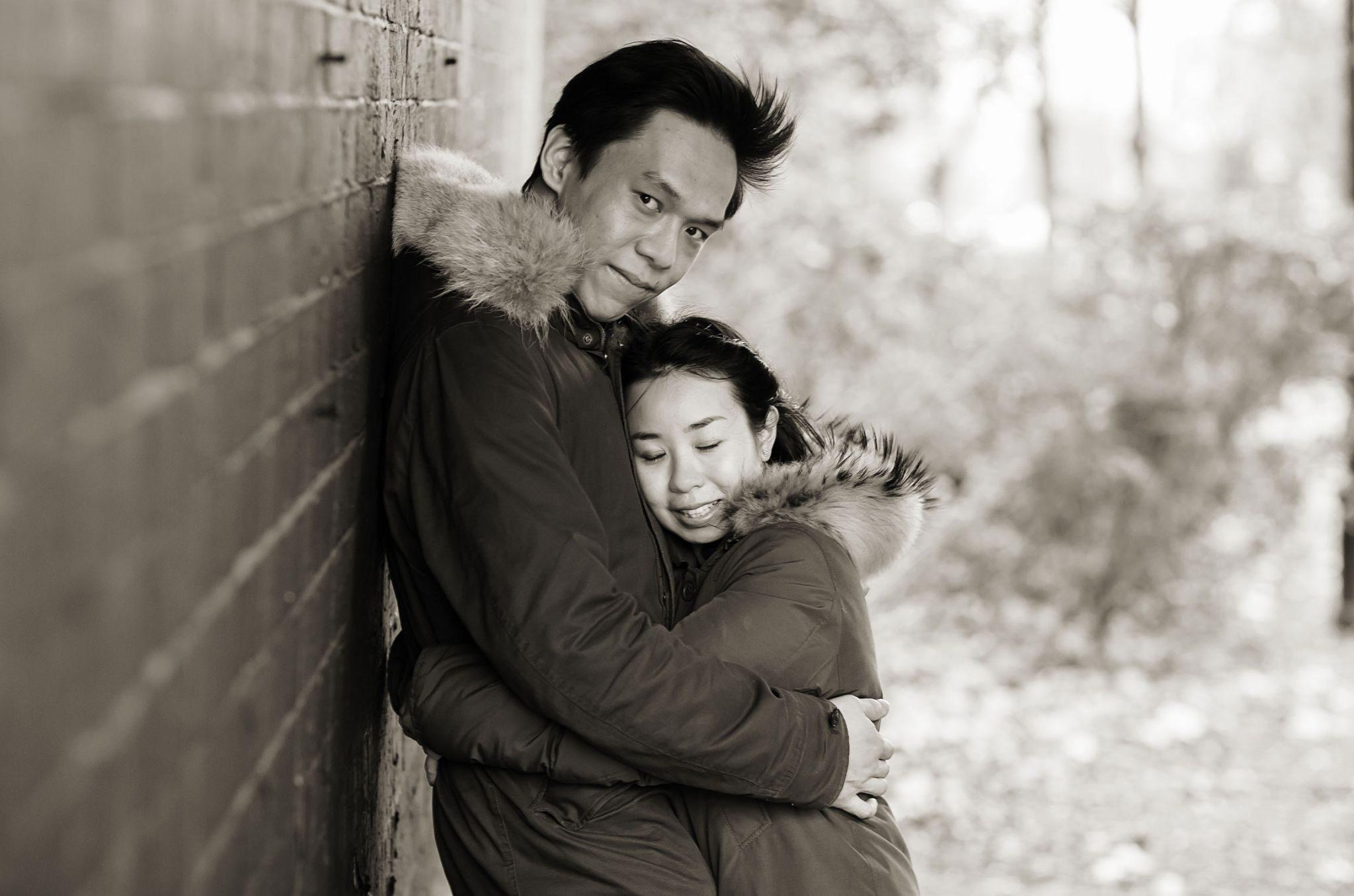 Chinese engagement couple under London railway  bridge