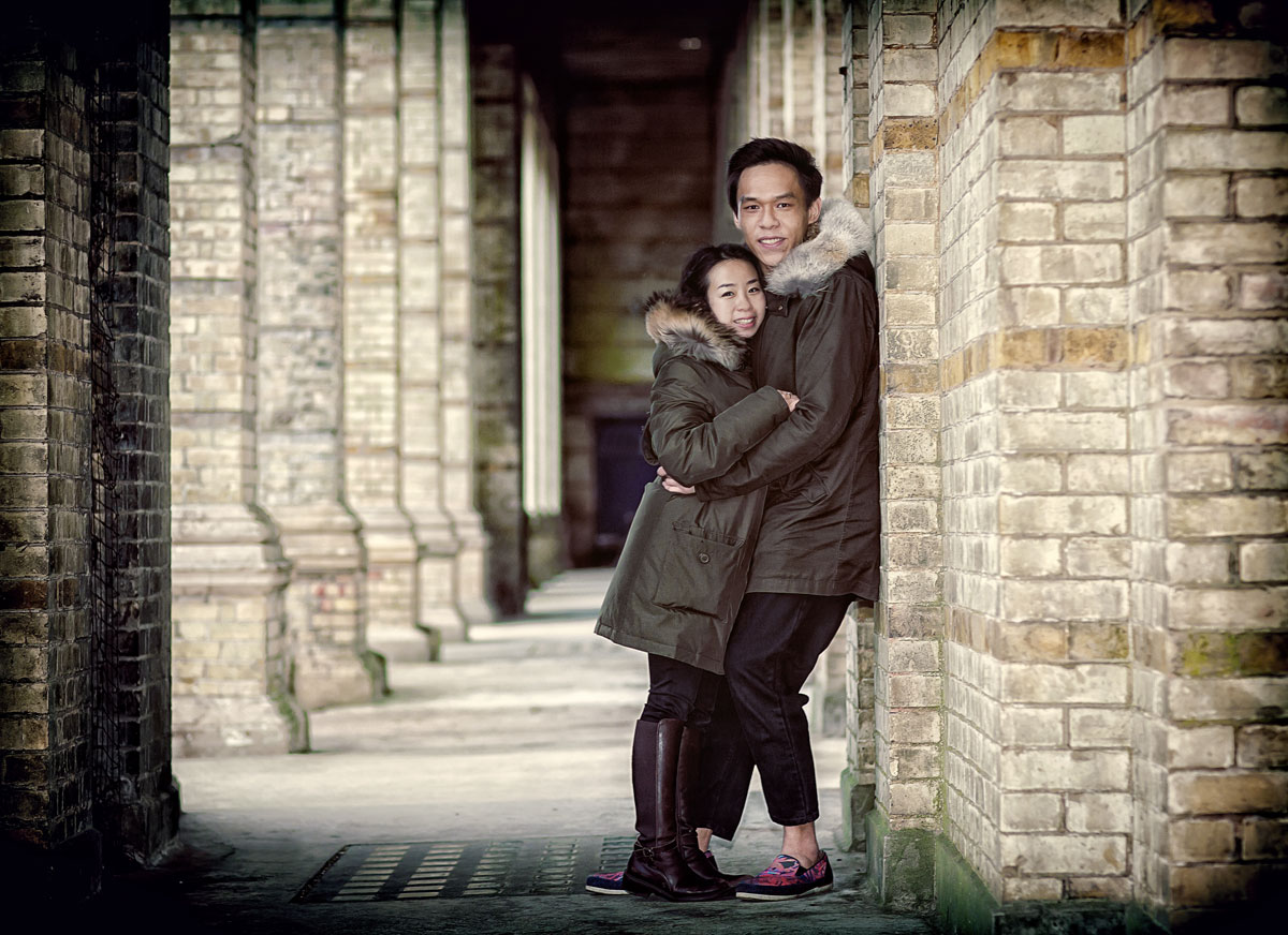 Couple pose and smile under Alexandra Palace Arch photo