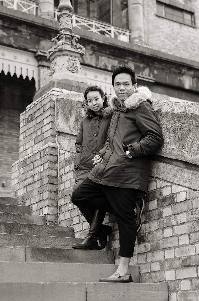 Couple pose for engagement photos on Alexandra Palace steps