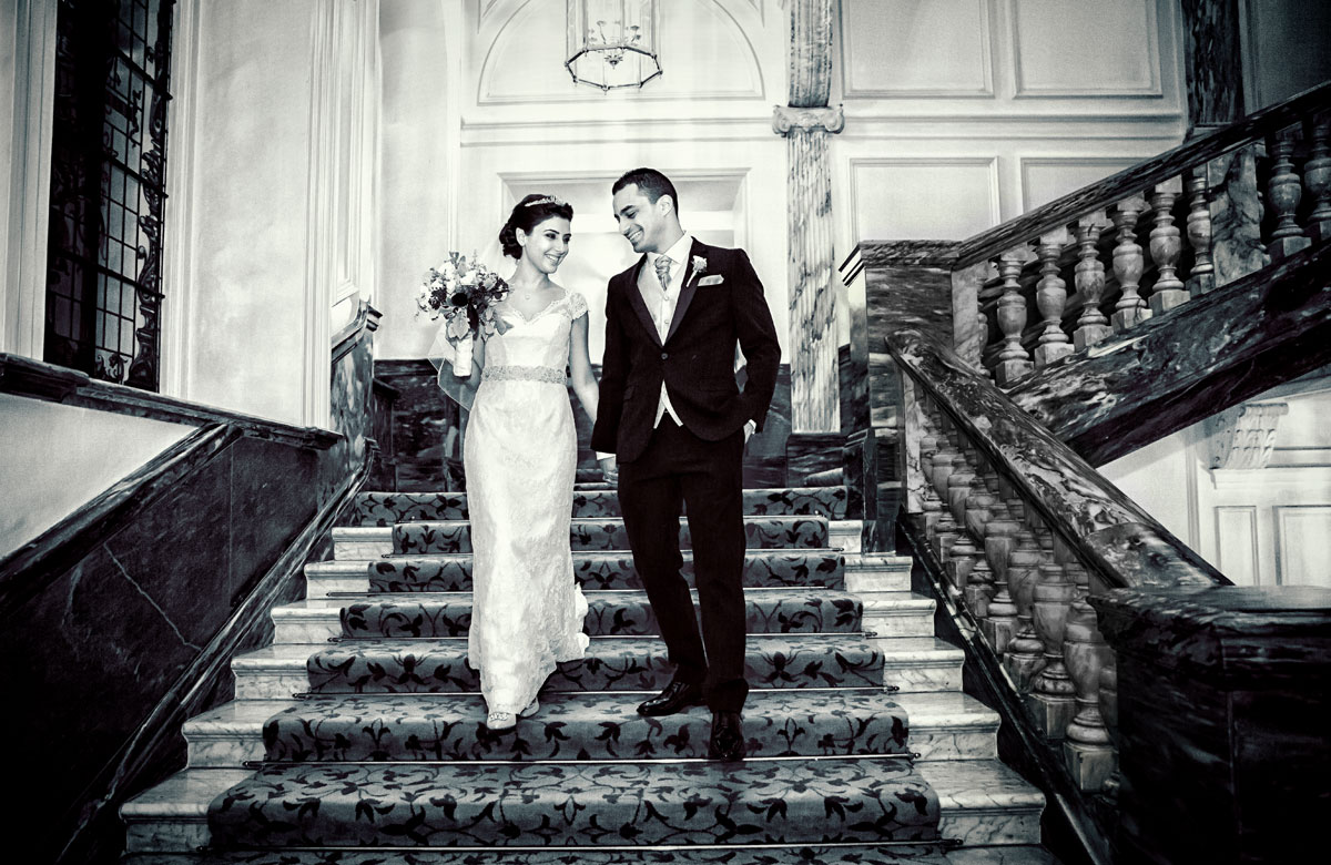 Royal couple walk down stairs at Landmark Hotel wedding