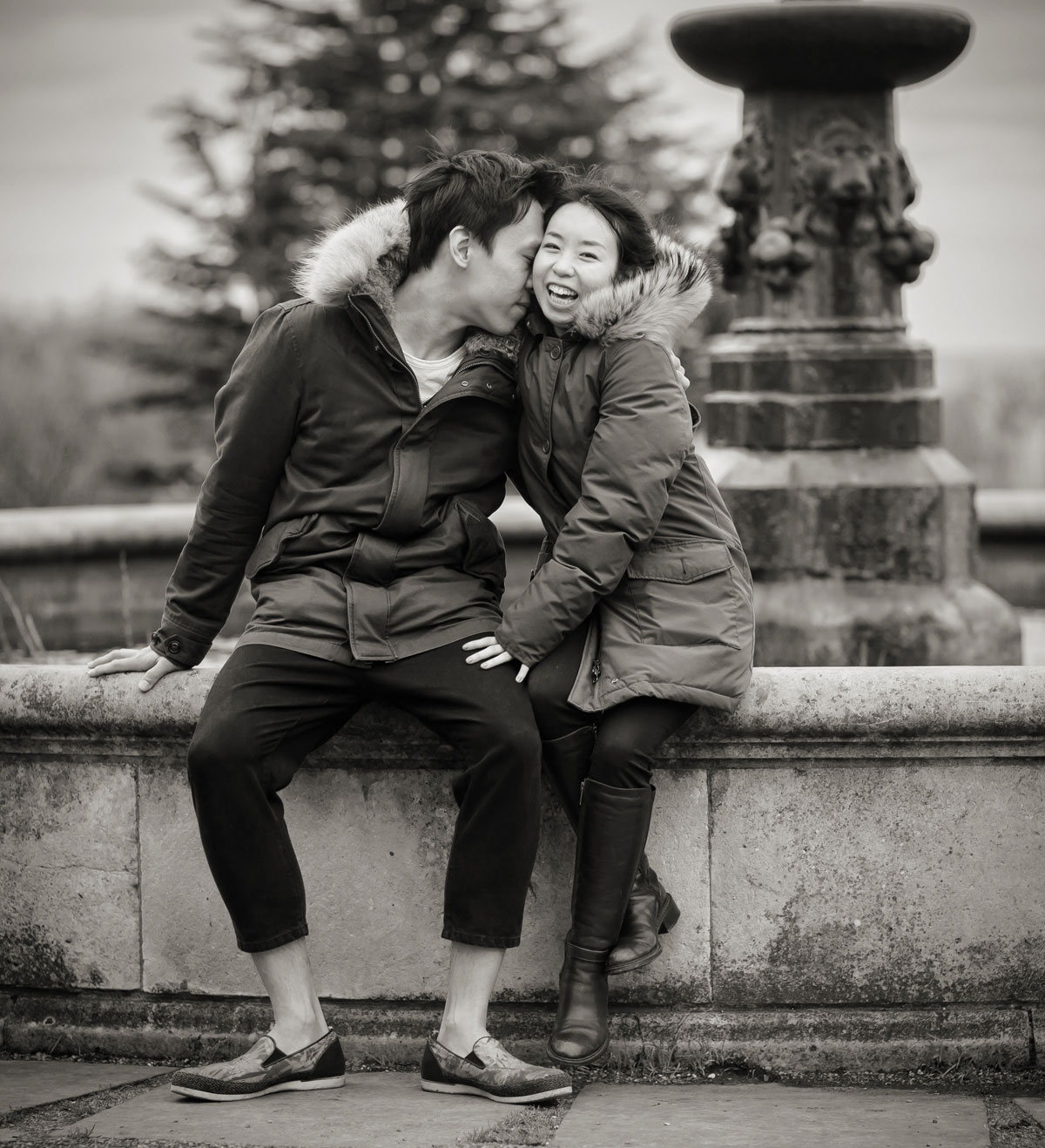 Wedding couple laugh by Italian fountains at Alexandra Palace