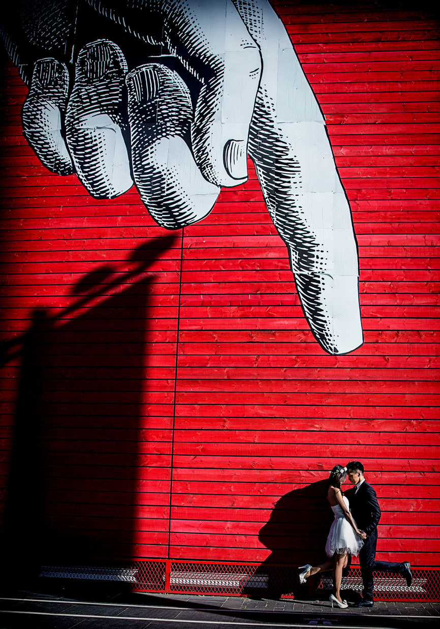 wedding couple under finger London southbank