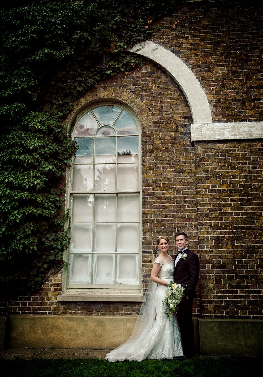 Bride and groom outside Hampton Court House
