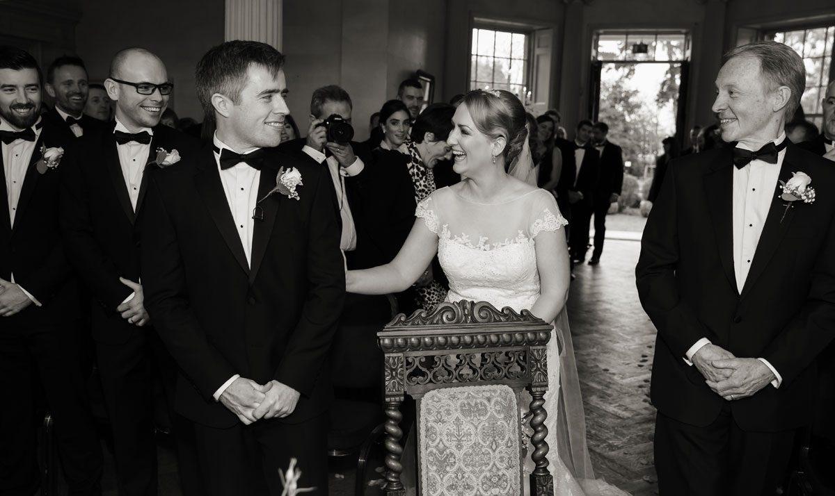 Bride greets groom at Hampton Court wedding ceremony